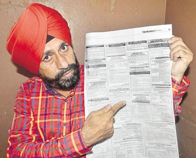 Congress councillor Raj Kanwalpreet Pal Singh Lucky showing the advertisement given by the state government at a press conference in Amritsar on Sunday.