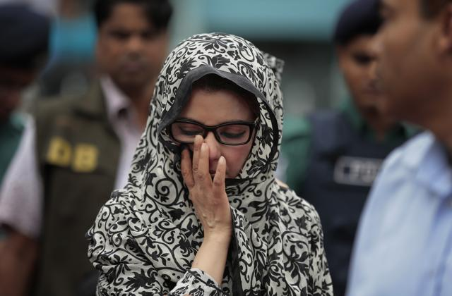 An unidentified relative of one of the victims of the attack on Holey Artisan Bakery reacts as people pay tribute to the deceased, at a stadium in Dhaka.(AP)