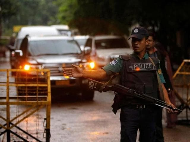 A policeman keeps watch near the Holey Artisan Bakery and the O'Kitchen Restaurant in Dhaka after a terror attack.
