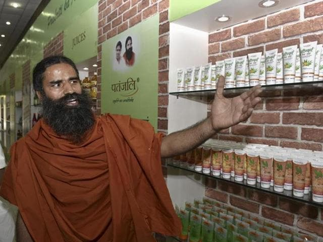 Yoga guru Baba Ramdev shows Patanjali's products during press conference in New Delhi on  April 26, 2016. Advertising watchdog ASCI has rapped Patanjali Ayurved for unfairly denigrating products of its rivals in ads.