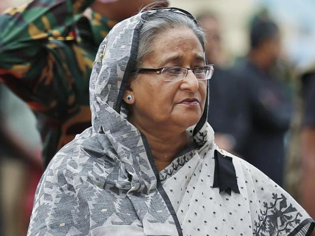 Bangladesh's Prime Minister Sheikh Hasina offers her tribute to the victims of the attack.(AP Photo)