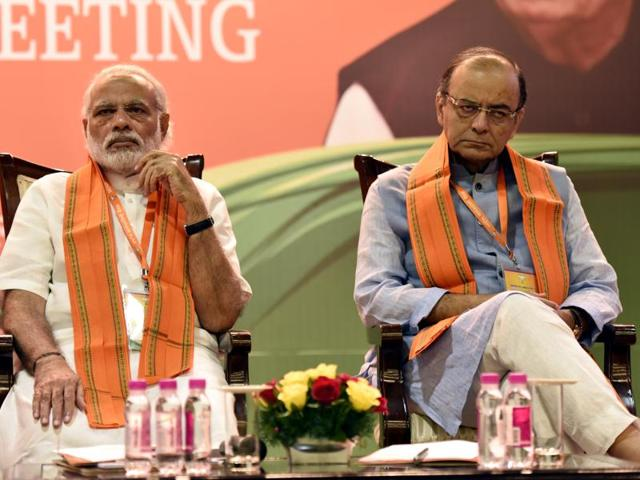 In this file photo, Prime Minister Narendra Modi and finance minister Arun Jaitley can be seen at a BJPmeeting in New Delhi.