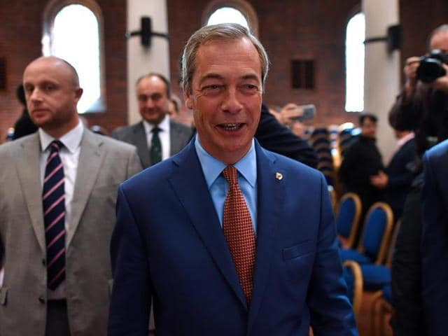 Nigel Farage, the leader of the United Kingdom Independence Party (UKIP), leaves a news conference after announcing that he was stepping down as leader of the party.