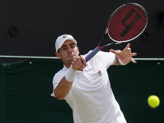 John Isner reacts during his marathon third-round match against Jo-Wilfried Tsonga.