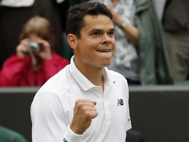 Milos Raonic of Canada celebrates after beating David Goffin of Belgium in their men's singles match.