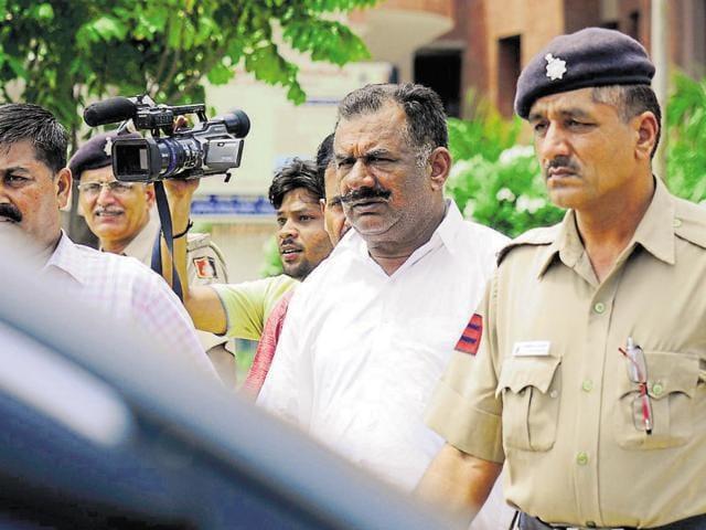 Former inspector Tarsem Singh Rana in police custody on Sunday.