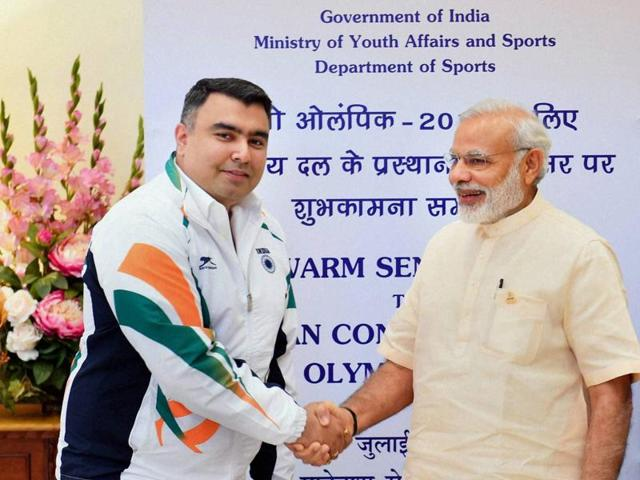 Prime Minister Narendra Modi poses for a photograph with members of India's Rio Olympics contingent.