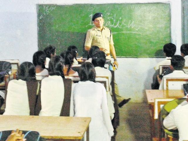 AP Singh, Hoshangabad SP, teaching Class 10 students at SNG School of Excellence in Hoshangabad on Friday.