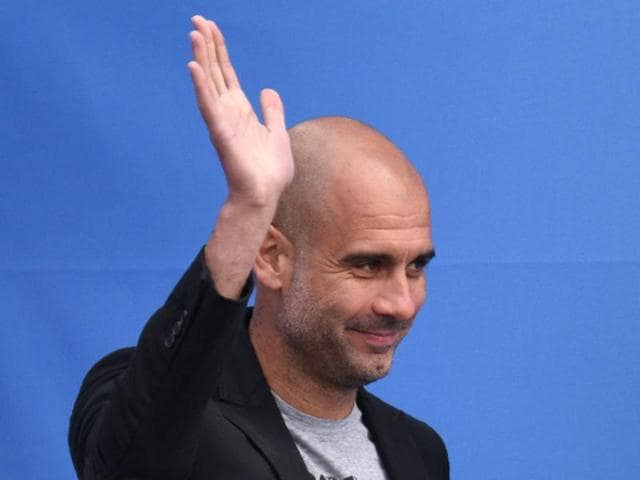 Pep Guardiola speaks to Manchester City fans as he is officially unveiled as the club's new manager at the City Football Academy in Manchester, England on July 3, 2016.