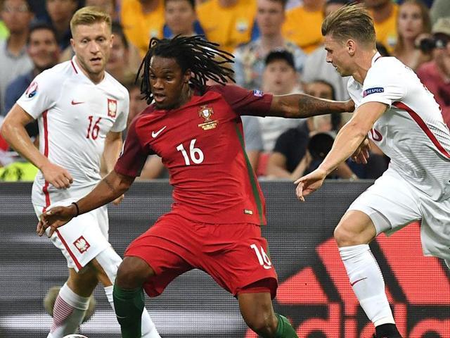 Portugal's midfielder Renato Sanches (C) vies with Poland's midfielder Jakub Blaszczykowski.