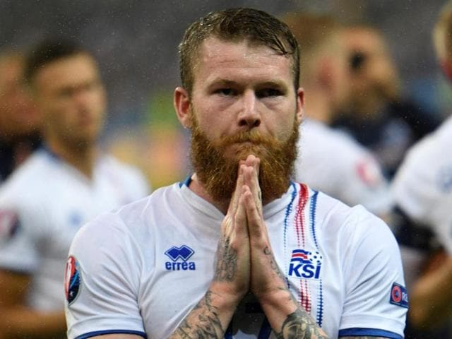 Iceland's midfielder Aron Gunnarsson reacts after the Euro 2016 quarter-final football match.