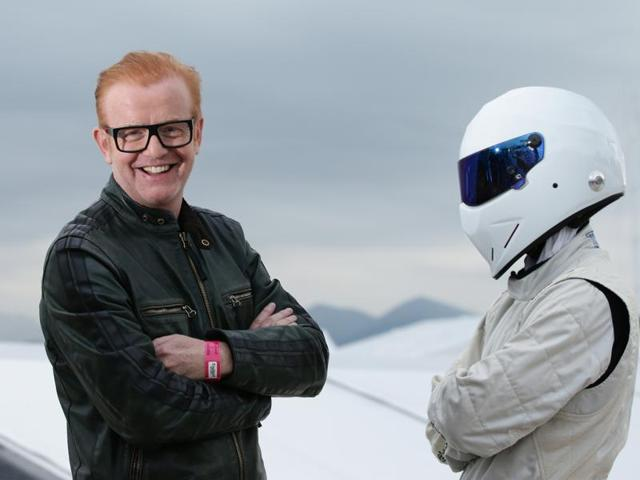File photo from files of Chris Evans, left, standing with 'The Stig' in Cannes, France.