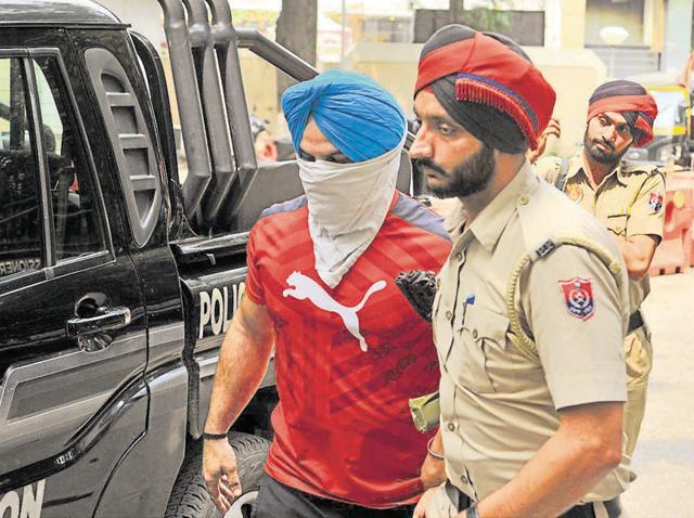 Police taking murder suspect Rajan Kochar to a court in Jalandhar on Sunday.