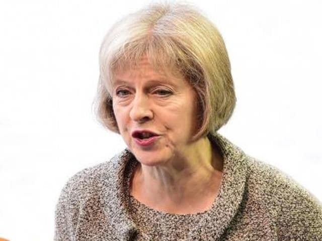 File photo of home secretary Theresa May, who commissioned the review of Shariah law in Britain.