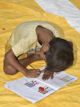 The classes under the IIT flyover start at 8am where kids are taught English alphabets, formation of words, varnamala and counting etc.
