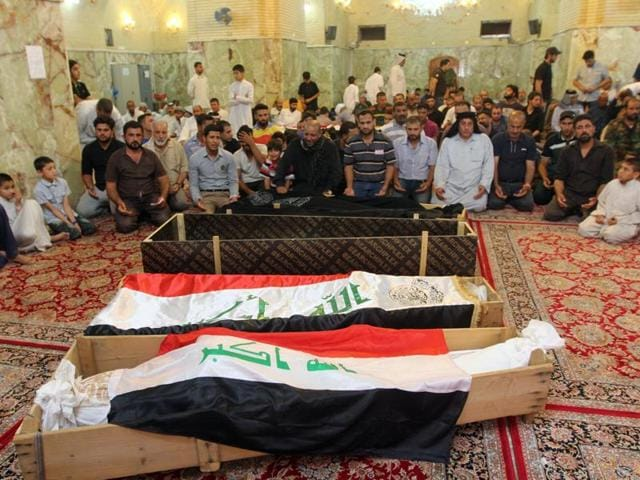 Mourners react during a funeral of a victim who was killed in a suicide blast in the Karrada shopping area in Baghdad.