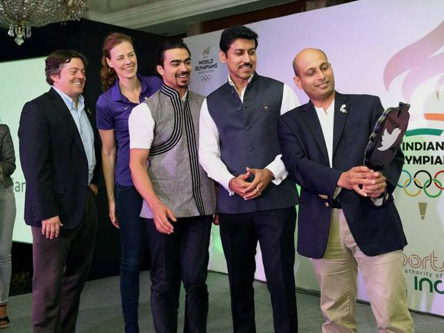 Olympic silver medallist and minister Rajyavardhan Rathore (second  from right) and Winter Olympian Shiva Keshavan (centre) at the launch of the Olympians Association of India in New Delhi on Monday.