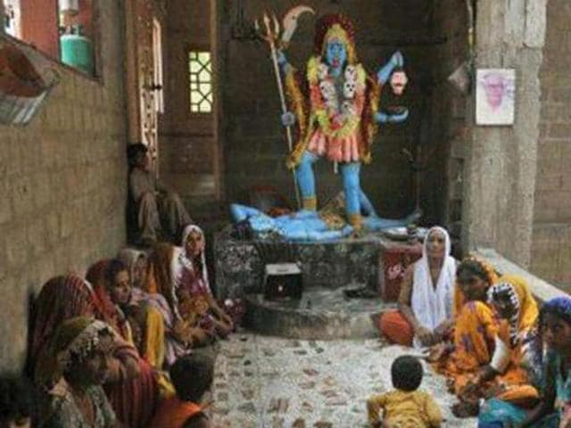 A file photo of Pakistani Hindus at The Shang Bhavan Temple in Maklei, in Thatta district, Pakistan.  Pakistan's capital Islamabad does not have a temple for Hindus and a parliamentary panel has ask the government to build  one.