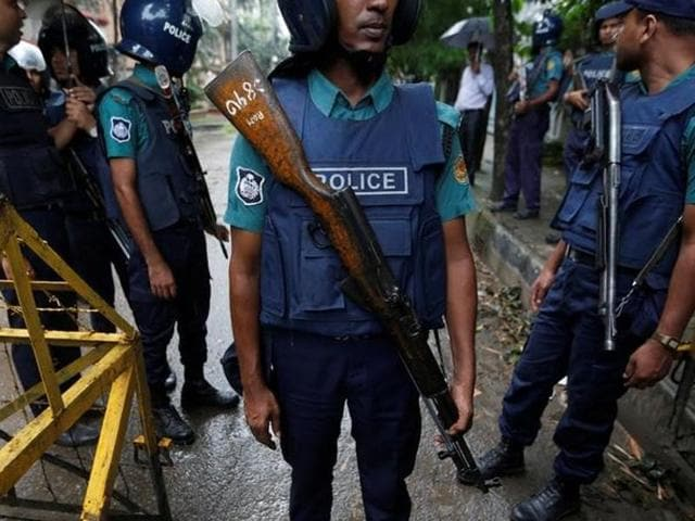 Policemen stand guard along a road leading to the Holey Artisan Bakery and the O'Kitchen Restaurant after gunmen attacked, in Dhaka, Bangladesh.
