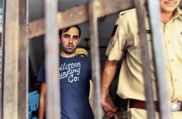 Police take accused Siddharth Maharia in custody after producing him in a court in Jaipur.