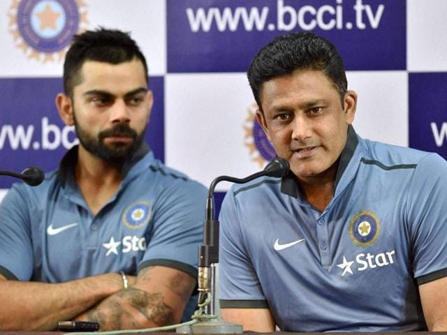 Head Coach Anil Kumble speaks as Captain Virat Kohli looks on at a press conference.