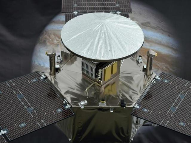 A 1/4 scale model of NASA's Juno Spacecraft is seen in front of an image of Jupiter, at the Jet Propulsion Laboratory (JPL) in Pasadena, California.
