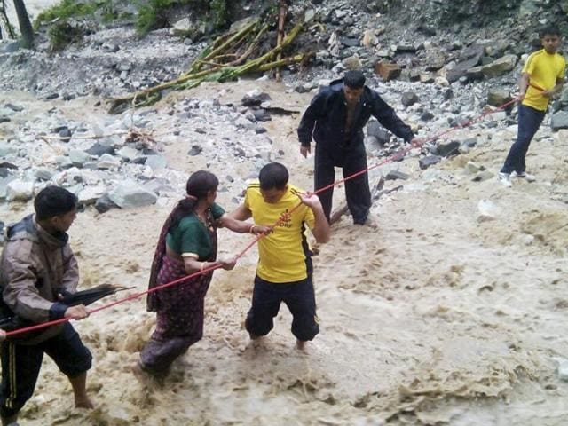 SDRF personnel conducting rescue operations after heavy rains in Uttarakhand on Saturday.(HT Photo)