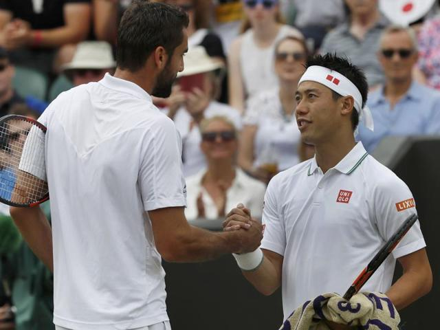 Kei Nishikori of Japan returns to Marin Cilic of Croatia during their men's singles match.