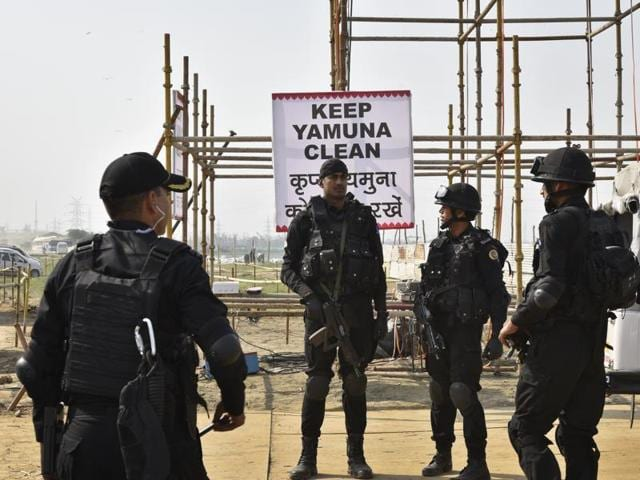 A squad of the National Security Guard (NSG) stands guard near the venue for the World Culture Festival at Yamuna bank.