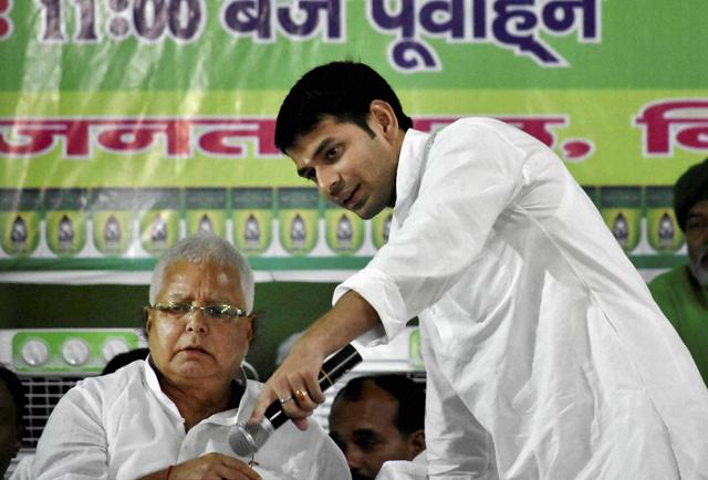RJD chief Lalu Prasad with his son and Bihar health minister Tej Pratap at party'ss foundation day function in Patna.