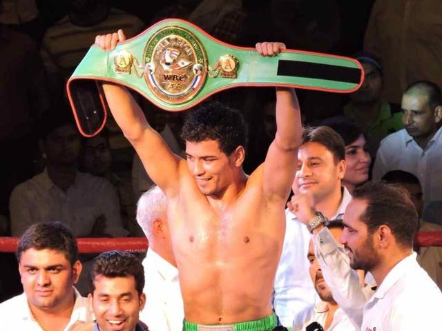 Indian boxer Neeraj Goyat wins the WBC Asian Championship in India on May 30, 2015.