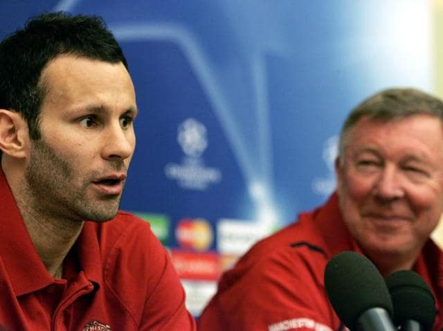 Former Manchester United manager Sir Alex Ferguson (right)as he looks towards midfielder Ryan Giggs during a press conference in Rome.