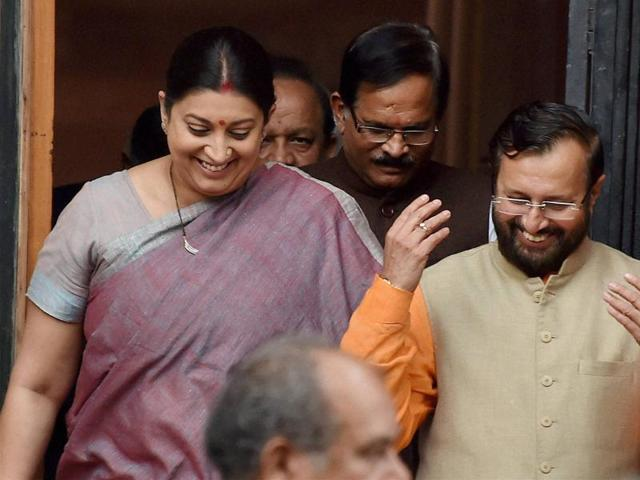 Union minister Smriti Irani with HRD minister Prakash Javadekar after a Cabinet meeting at South Block in New Delhi on Tuesday.(PTI Photo)