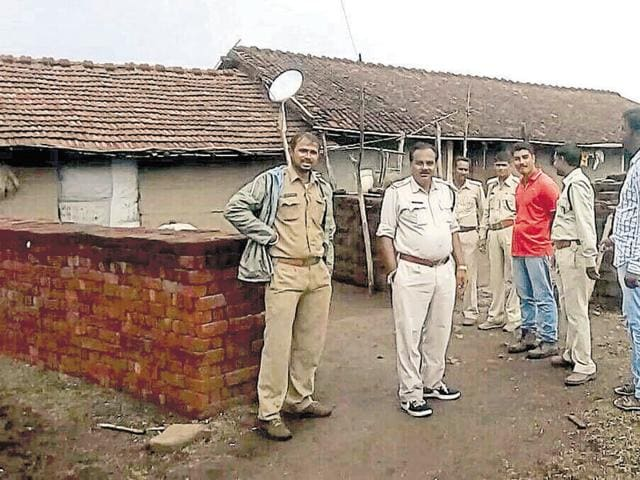 A team of forest department personnel outside the hut where villagers locked the leopard on Monday.