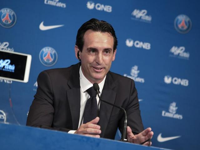 Paris Saint Germain's new Spanish manager Unai Emery answers reporters at the Parc des Princes stadium in Paris on Monday, July 4, 2016.