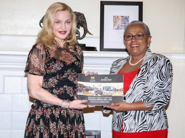 Singer-songwriter Madonna poses for a photograph with Kenyan First Lady Margaret Kenyatta as she receives a Beyond Zero campaign technical report at State House in Nairobi, Kenya, July 4, 2016.
