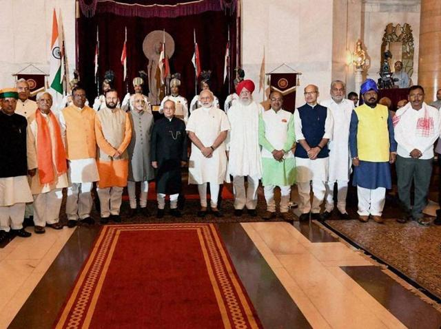 President Pranab Mukherjee, Vice President Hamid Ansari and Prime Minister Narendra Modi with the newly sworn-in ministers at the oath taking ceremony at Rashtrapati Bhavan in New Delhi.