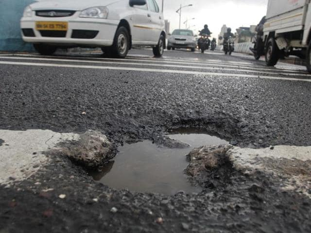 Commuters complained of potholes on the Kapurbwadi Flyover.