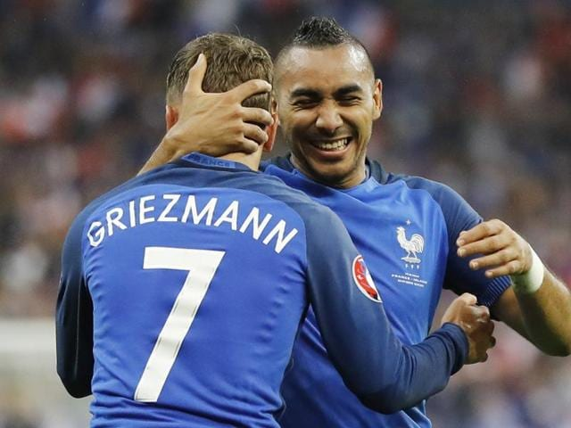 France's Dimitri Payet (right) congratulates his teammate Antoine Griezmann after scoring their fourth goal during the Euro 2016 quarterfinal match against Iceland, at the Stade de France in Saint-Denis, north of Paris.