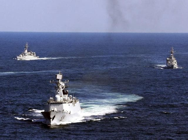 In this 2012 file photo, Chinese navy vessels take part in a drill in the waters off Zhoushan in east China's Zhejiang province.