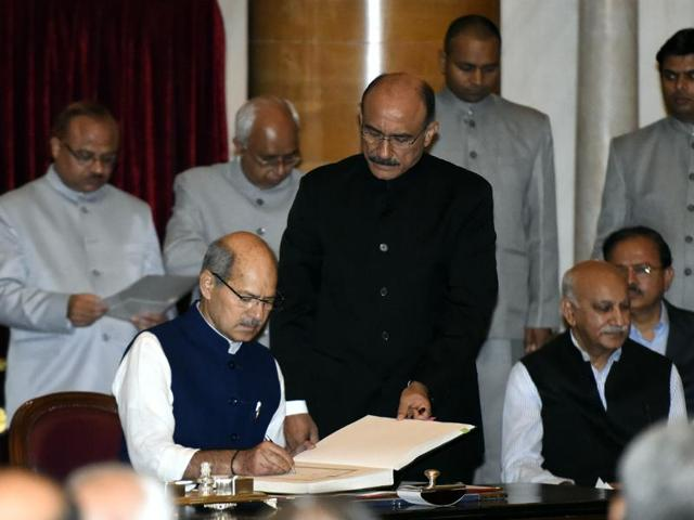 Member of Parliament Anil Madhav Dave takes oath as a minister of state in the presence of President Pranab Mukherjee.