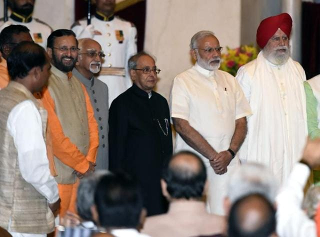President Pranab Mukherjee, Prime Minister Narendra Modi and vice-president Hamid Ansari with newly inducted ministers at the Rashtrapati Bhavan.