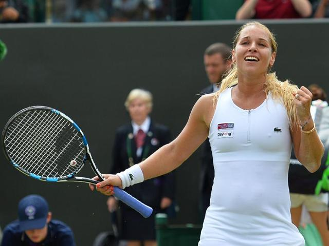 Slovakia's Dominika Cibulkova celebrates after beating Poland's Agnieszka Radwanska in her women's singles fourth round match on the eighth day of the 2016 Wimbledon Championships at The All England Lawn Tennis Club in Wimbledon, southwest London.