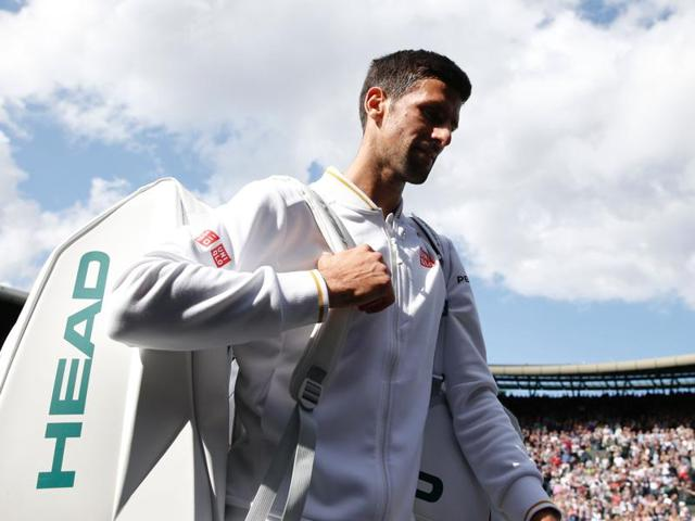 Serbia's Novak Djokovic returns to US player Sam Querrey during their men's singles third round match on the sixth day of the 2016 Wimbledon Championships at The All England Lawn Tennis Club in Wimbledon.