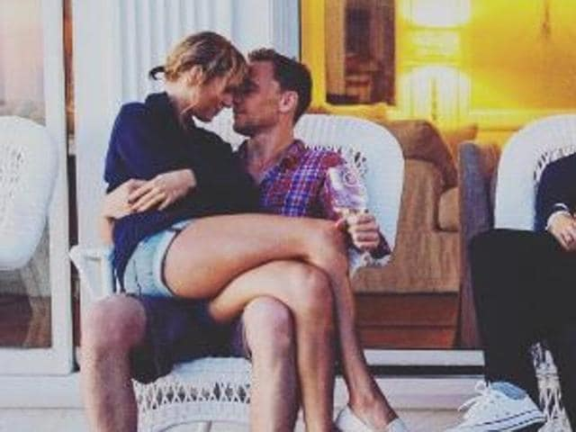 Taylor Swift and Blake Lively sat in the laps of their respective beau and husband, Tom Hiddleston and Ryan Reynolds for this picture.