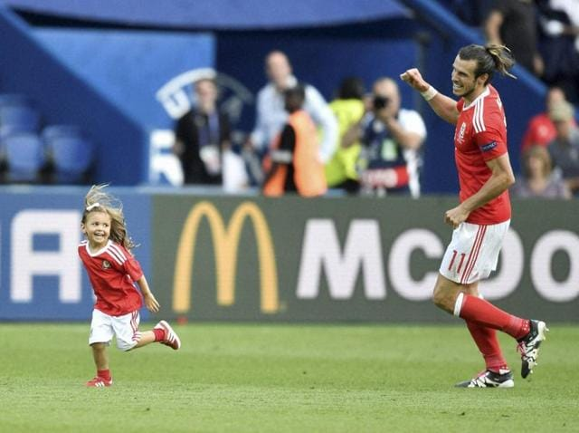 Wales' Gareth Bale celebrates with his daughter Alba after winning the Euro 2016 round of 16 football match between Wales and Northern Ireland, at the Parc des Princes stadium in Paris.