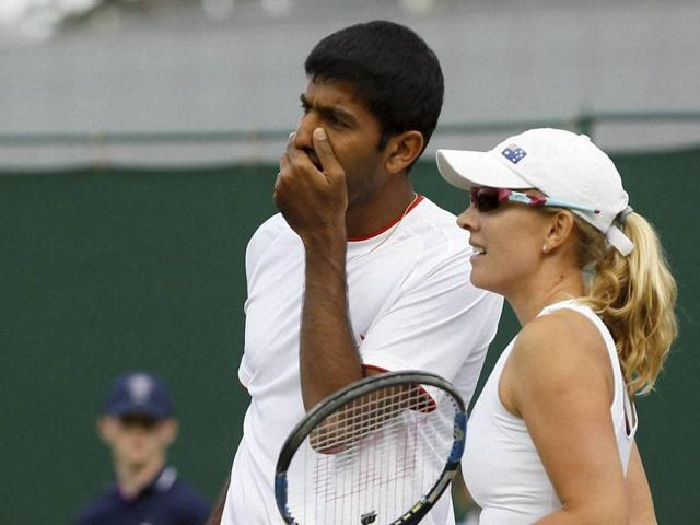 Rohan Bopanna talks to playing partner Anastasia Rodionova during their mixed doubles match against Juan-Sebastian Cabal of Colombia and Maraiana Duque-Marino of Colombia on day nine of the Wimbledon Tennis Championships in London.