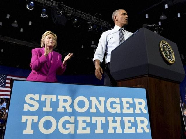 President Barack Obama and Democratic presidential candidate Hillary Clinton wave following a campaign event in Charlotte, North Carolina, on Tuesday.