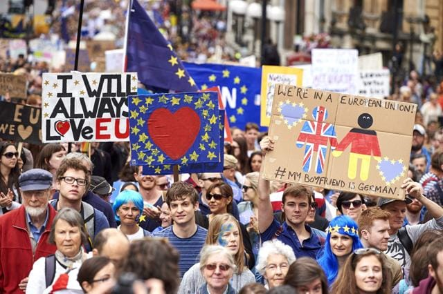 People hold up pro-Europe placards and European flags as thousands of protesters take part in a March for Europe, in London earlier in July to protest against Britain's vote to leave the EU, which has plunged the government into political turmoil and left the country deeply polarised.