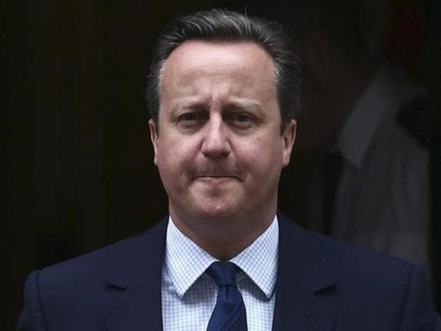 Britain's Prime Minister David Cameron leaves 10 Downing Street to attend Prime Minister's Questions at parliament in London.